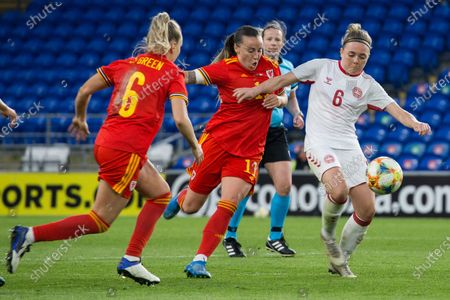Natasha Harding (11 Wales) challenges Nanna Christiansen (6 Denmark) for the ball during the International Friendly game between Wales and Denmark at Cardiff City Stadium in Cardiff, Wales.