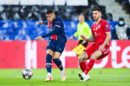 Kylian Mbappe of Paris Saint-Germain and Lucas Hernandez of Bayern Munich