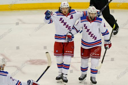 New York Rangers left wing Artemi Panarin (10) pants to a teammate as he celebrates with Rangers center Colin Blackwell (43) after scoring a goal during the third period of an NHL hockey game against the New Jersey Devils, in Newark, N.J