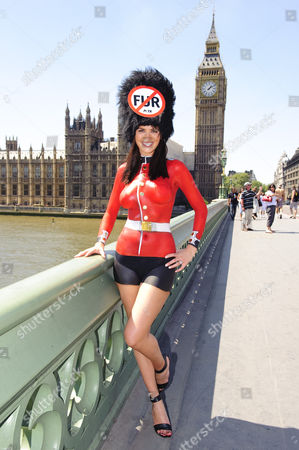 Model Lucy Clarkson bodypainted in Guards uniform