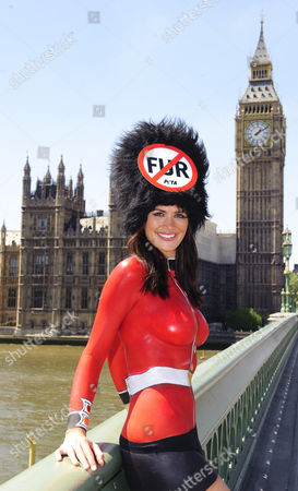 Stock Image of Model Lucy Clarkson bodypainted in a Guards uniform