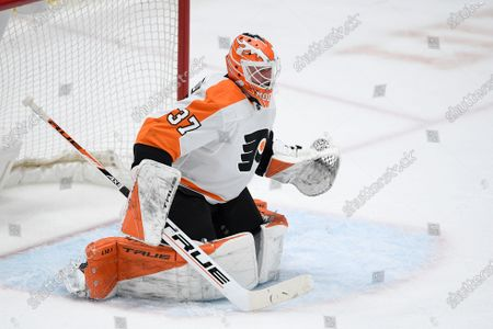 Stock Picture of Philadelphia Flyers goaltender Brian Elliott (37) in action during the first period of an NHL hockey game against the Washington Capitals, in Washington