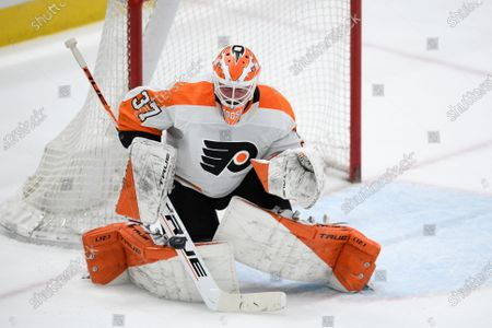 Stock Photo of Philadelphia Flyers goaltender Brian Elliott (37) stops the puck during the first period of an NHL hockey game against the Washington Capitals, in Washington
