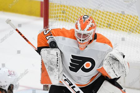Philadelphia Flyers goaltender Brian Elliott (37) stops the puck during the second period against the Washington Capitals in an NHL hockey game, in Washington