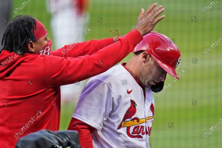 Stock Image of St. Louis Cardinals' Paul Goldschmidt, right, is congratulated by teammate Carlos Martinez after hitting a solo home run during the first inning of a baseball game against the Washington Nationals, in St. Louis