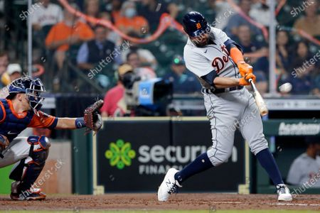 Detroit Tigers' Renato Nunez hits a two-run home run in front of Houston Astros catcher Jason Castro during the fourth inning of a baseball game, in Houston