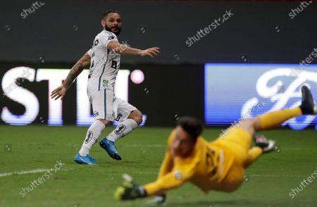 Para of Brazil's Santos scores his side's 2nd goal against goalkeper Jose Antonio Devecchi of Argentina's San Lorenzod during a Copa Libertadores soccer match at the Mane Garrincha stadium in Brasilia, Brazil