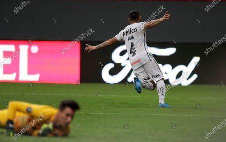 Para of Brazil's Santos celebrates after scoring his side's 2nd goal against goalkeper Jose Antonio Devecchi of Argentina's San Lorenzod during a Copa Libertadores soccer match at the Mane Garrincha stadium in Brasilia, Brazil