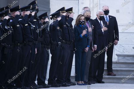 Stock Photo of US Speaker of the House Nancy Pelosi (4-R), Senate Majority Leader Chuck Schumer (3-R), House Majority Leader Steny Hoyer (2-R) and Republican Representative of Louisiana Steve Scalise (R) watch with US Capitol Police officers as the casket of US Capitol Police Officer William Evans is carried by a joint service honor guard and placed into a hearse at the East Front steps of the US Capitol after lying in honor in the Capitol Rotunda, in Washington, DC on April 13, 2021. A 'Tribute and Lying in Honor Ceremony' took place for Officer Evans, who was killed and another officer injured in the line of duty when a suspect rammed a vehicle at the North entrance of the Capitol on April.