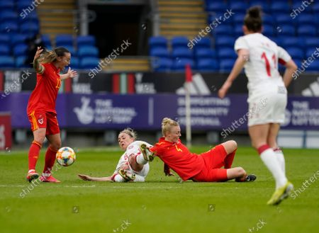 Natasha Harding (L) Wales Captain Sophie Ingle (4) and Nanna Christiansen are seen in action during the Womens Friendly match between Wales and Denmark at Cardiff City Stadium. Final score; Wales 1:1 Denmark)