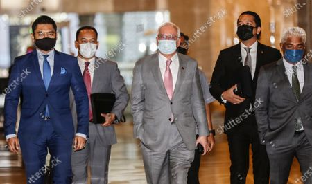 Malaysia's former prime minister Najib Razak (C) arrives at the Court of Appeal in Putrajaya, Malaysia, 14 April 2021. Malaysia's Court of Appeal continues the hearing on the former prime minister's bid to set aside his conviction on corruption charges in a case linked to a multibillion-dollar scandal at state fund 1Malaysia Development Berhad (1MDB).