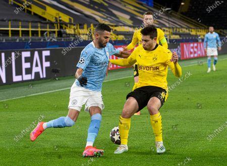 Riyad Mahrez of Manchester City and Raphael Guerreiro of Borussia Dortmund