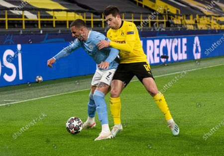 Kyle Walker of Manchester City and Raphael Guerreiro of Borussia Dortmund
