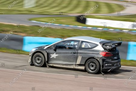 Stock Image of Matt Neal into Paddock Bend behind the wheel of the STARD ERX during the 5 Nations British Rallycross Championship Media Day at Lydden Hill Race Circuit on 14th April 2021