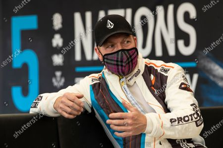 Stock Image of A relaxed Sir Chris Hoy after his opening drive in the electric STARD ERX during the 5 Nations British Rallycross Championship Media Day at Lydden Hill Race Circuit on 14th April 2021
