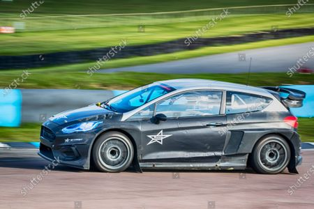 Sir Chris Hoy at the wheel of the STARD ERX Electric Supercar during the 5 Nations British Rallycross Championship Media Day at Lydden Hill Race Circuit on 14th April 2021
