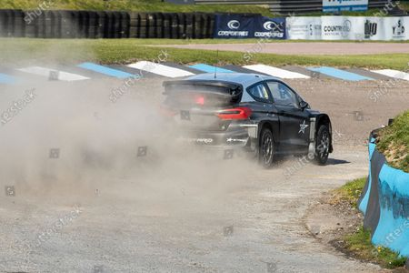 Sir Chris Hoy throws the Stard Ford Electric supercar through Paddock Bend during the 5 Nations British Rallycross Championship Media Day at Lydden Hill Race Circuit on 14th April 2021