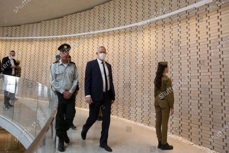 Benny Gantz, Israel's Minister of Defense, center, walks along a path lined with bricks representing fallen service members at the National Hall For Israel's Fallen during a Memorial Day ceremony at the military cemetery at Mount Herzl in Jerusalem, 14 April 2021.