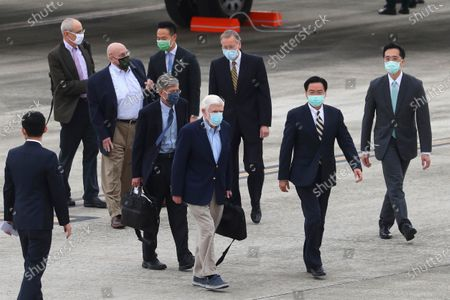 Former U.S. senator Chris Dodd, center left is followed by former U.S. Deputies Secretary of State James Steinberg and Richard Armitage as they are shown the way by Taiwan Foreign Minister Joseph Wu, center right upon arrival in Taipei, Taiwan on . The former U.S. senator and two ex-State Department officials arrived in Taiwan on Wednesday at a time of tense relations with China, Taiwan's Foreign Ministry said