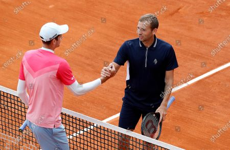 Hubert Hurkacz of Poland shakes hands with Daniel Evans (R) of Britain after their third round match at the Monte-Carlo Rolex Masters tournament in Roquebrune Cap Martin, France, 14 April 2021.