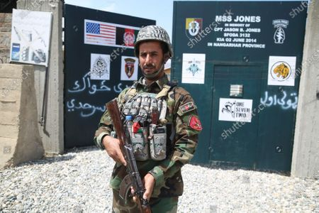 Stock Photo of An Afghan Army soldier stands guard outside a military base that was previously in use by the US soldiers, in Haska Meyna district of Nangarhar province, Afghanistan, 14 April 2021. According to reports, US President Joe Biden is set to announce that American troops will leave Afghanistan by 11 September. Violence has escalated in the country despite the ongoing peace talks between representatives of Afghan President Ashraf Ghani and the Taliban since last year. However, these talks have made little progress so far.