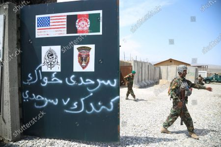 Stock Image of Afghan Army soldiers secure a military base that was previously in use by the US soldiers, in Haska Meyna district of Nangarhar province, Afghanistan, 14 April 2021. According to reports, US President Joe Biden is set to announce that American troops will leave Afghanistan by 11 September. Violence has escalated in the country despite the ongoing peace talks between representatives of Afghan President Ashraf Ghani and the Taliban since last year. However, these talks have made little progress so far.