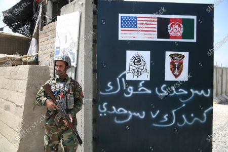 An Afghan Army soldier stands guard outside a military base that was previously in use by the US soldiers, in Haska Meyna district of Nangarhar province, Afghanistan, 14 April 2021. According to reports, US President Joe Biden is set to announce that American troops will leave Afghanistan by 11 September. Violence has escalated in the country despite the ongoing peace talks between representatives of Afghan President Ashraf Ghani and the Taliban since last year. However, these talks have made little progress so far.