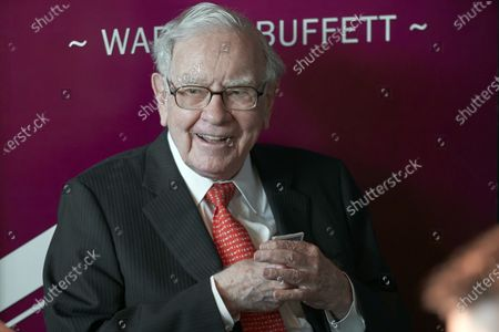 """Warren Buffett, Chairman and CEO of Berkshire Hathaway, smiles as he plays bridge following the annual Berkshire Hathaway shareholders meeting in Omaha, Neb. A multitude of big-name businesses and high-profile individuals, including Buffett, Amazon and Facebook are showing their support for voters' rights. In a letter published in The New York Times, the group stressed that Americans should be allowed to cast ballots for the candidates of their choice. """"For American democracy to work for any of us, we must ensure the right to vote for all of us,"""" they wrote"""