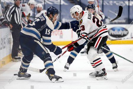 Chicago Blackhawks forward Philipp Kurashev, right, works against Columbus Blue Jackets defenseman Michael Del Zotto during an NHL hockey game in Columbus, Ohio, . The Blackhawks won 4-3 in overtime