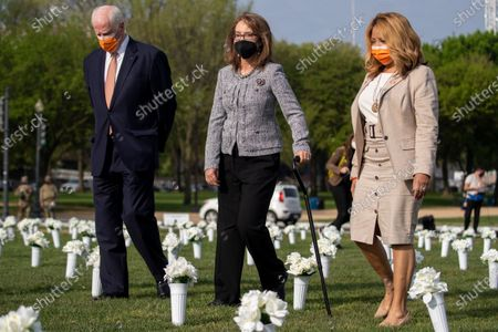 Former Congresswoman Gabby Giffords, with Democratic Representative from California Mike Thompson (2-L) and Democratic Representative from Georgia Lucy McBath (R), arrives to hosts a press conference about the importance of federal action on gun safety at the Gun Violence Memorial on the National Mall in Washington, DC, USA, 14 April 2021. The installation by the 'Giffords: Courage to Fight Gun Violence' advocacy group features 40,000 white silk flowers honoring the nearly 40,000 Americans who die every year from gun violence.