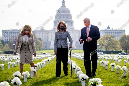 Former Congresswoman Gabby Giffords, with Democratic Representative from California Mike Thompson (R) and Democratic Representative from Georgia Lucy McBath (L), arrives to hosts a press conference about the importance of federal action on gun safety at the Gun Violence Memorial on the National Mall in Washington, DC, USA, 14 April 2021. The installation by the 'Giffords: Courage to Fight Gun Violence' advocacy group features 40,000 white silk flowers honoring the nearly 40,000 Americans who die every year from gun violence.