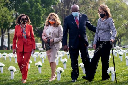 Former Congresswoman Gabby Giffords (R), with Speaker of the House Nancy Pelosi (L), Democratic Representative from Georgia Lucy McBath (2-L) and House Majority Whip James Clyburn (2-R) arrives to host a press conference about the importance of federal action on gun safety at the Gun Violence Memorial on the National Mall in Washington, DC, USA, 14 April 2021. The installation by the 'Giffords: Courage to Fight Gun Violence' advocacy group features 40,000 white silk flowers honoring the nearly 40,000 Americans who die every year from gun violence.