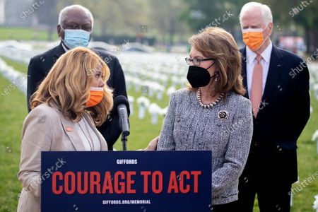 Former Congresswoman Gabby Giffords (R) talks with Democratic Representative from Georgia Lucy McBath (L) during a press conference about the importance of federal action on gun safety at the Gun Violence Memorial on the National Mall in Washington, DC, USA, 14 April 2021. The installation by the 'Giffords: Courage to Fight Gun Violence' advocacy group features 40,000 white silk flowers honoring the nearly 40,000 Americans who die every year from gun violence.