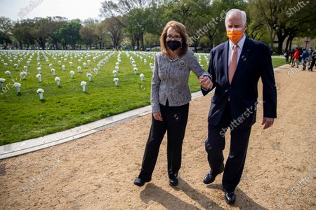 Former Congresswoman Gabby Giffords and Democratic Representative from California Mike Thompson (R) depart following a press conference about the importance of federal action on gun safety at the Gun Violence Memorial on the National Mall in Washington, DC, USA, 14 April 2021. The installation by the 'Giffords: Courage to Fight Gun Violence' advocacy group features 40,000 white silk flowers honoring the nearly 40,000 Americans who die every year from gun violence.
