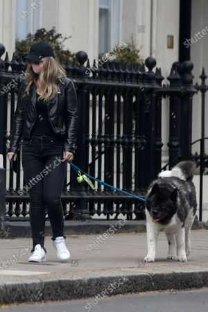 Exclusive - Natalie Viscuso walking Henry Cavill's dog Kal around Central London