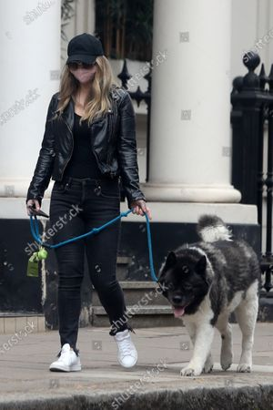 Stock Image of Exclusive - Natalie Viscuso walking Henry Cavill's dog Kal around Central London