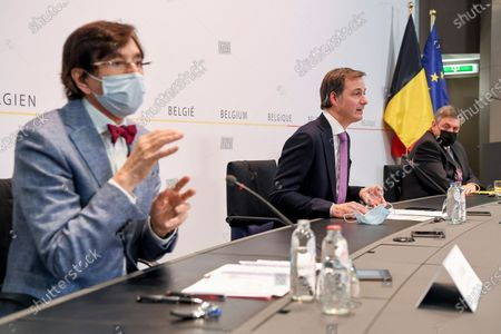 Walloon Minister President Elio Di Rupo, Prime Minister Alexander De Croo and Flemish Minister President Jan Jambon pictured during a press conference after a meeting of the consultative committee with ministers of the Federal government, the regional governments and the community governments, Wednesday 14 April 2021 in Brussels. Measures to fight against the Covid-19 pandemy will be discussed.