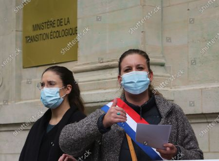 Stock Image of The water campaign protest is not for us to the multinationals in the presence of Mathilde Panot and Ugo Bernalicis, the deputies La France Insubmitted, in front of the Ministry of Ecological Transition.