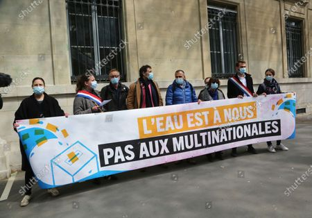 Stock Picture of The water campaign protest is not for us to the multinationals in the presence of Mathilde Panot and Ugo Bernalicis, the deputies La France Insubmitted, in front of the Ministry of Ecological Transition.