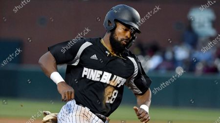 Pine Bluff baserunner Kacy Higgins (28) against Arkansas during an NCAA baseball game, in Fayetteville, Ark