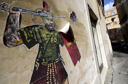 A mural by street artist Laika is dedicated to AS Roma's former captain Daniele De Rossi dressed like a Roman legionary fighting the COVID-19 coronavirus in Rome, Italy, 14 April 2021.