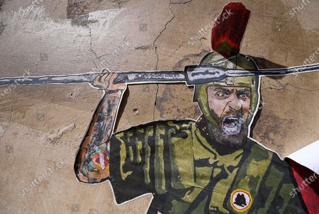 Stock Picture of A mural by street artist Laika is dedicated to AS Roma's former captain Daniele De Rossi dressed like a Roman legionary fighting the COVID-19 coronavirus in Rome, Italy, 14 April 2021.