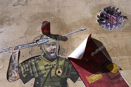 Editorial photo of Mural by Laika dedicated to De Rossi fighting COVID-19, Rome, Italy - 14 Apr 2021