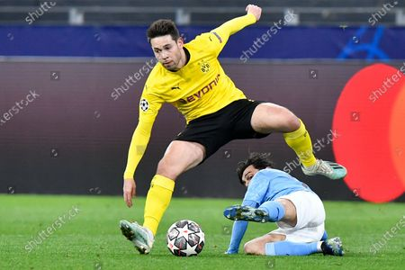 Dortmund's Raphael Guerreiro, top, challenges for the ball with Manchester City's Bernardo Silva during the Champions League quarterfinal second leg soccer match between Borussia Dortmund and Manchester City at the Signal Iduna Park stadium in Dortmund, Germany