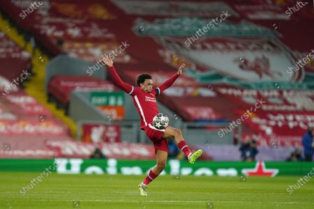 Stock Photo of Liverpool's Trent Alexander-Arnold controls the ball past during a Champions League quarter final second leg soccer match between Liverpool and Real Madrid at Anfield stadium in Liverpool, England