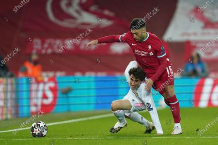 Stock Photo of Real Madrid's Alvaro Odriozola, left, is challenged by Liverpool's Alex Oxlade-Chamberlain during a Champions League quarter final second leg soccer match between Liverpool and Real Madrid at Anfield stadium in Liverpool, England