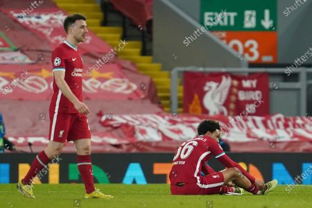 Liverpool's Trent Alexander-Arnold, right, and Liverpool's Diogo Jota at the end of the Champions League quarter final second leg soccer match between Liverpool and Real Madrid at Anfield stadium in Liverpool, England