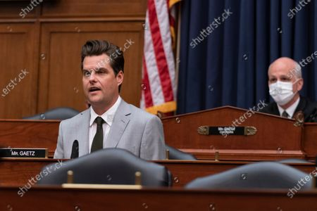 Rep. Matt Gaetz, R-Fla., questions a witness during a House Armed Services Committee hearing on Capitol Hill, in Washington. On the right is committee Chairman Adam Smith, D-Wash