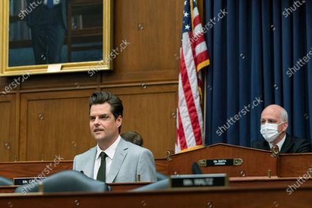 Stock Image of Rep. Matt Gaetz, R-Fla., questions witness during a House Armed Services Committee hearing on Capitol Hill, in Washington. On the right is committee Chairman Adam Smith of Wa
