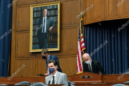 Rep. Matt Gaetz, R-Fla., attends a House Armed Services Committee hearing on Capitol Hill, in Washington. On the right is committee Chairman Adam Smith of Wa
